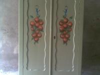 Sinaasappels op kast deuren geschilderd.